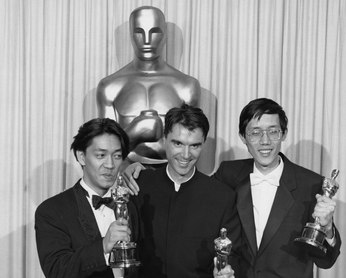 Ryuichi Sakamoto, David Byrne and Cong Su accept their Oscars for Best Original Score.