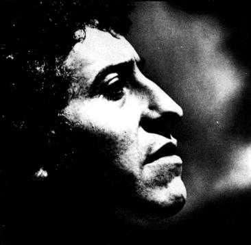 A black and white photograph of Victor Jara