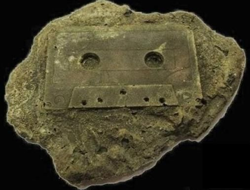 A tape cassette, or fossil.