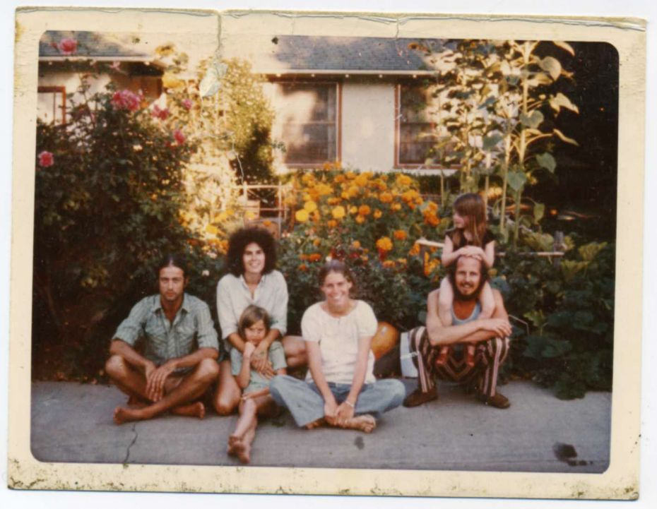 My family, circa 1972: me lounging in my mom's arms, with her (Shakespeare look-alike) boyfriend carrying my sister on his shoulders, a female friend, and the guy who lived in our garage (far left).