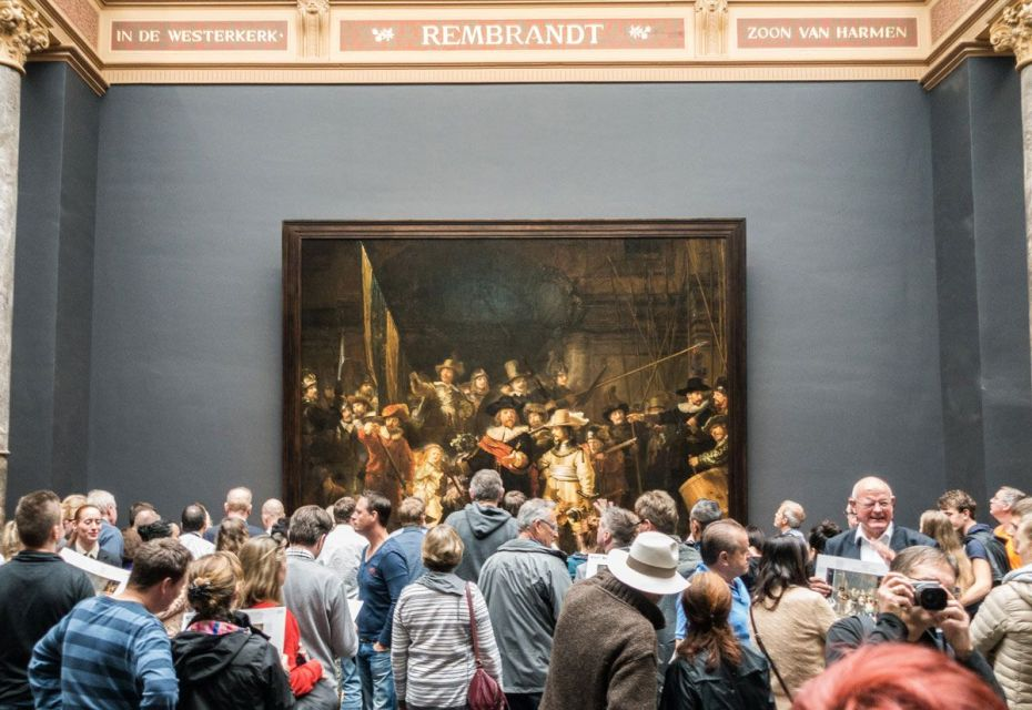 The crowd at Rijksmuseum, surrounding Rembrandt's famous 'Night Watch.'